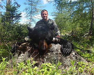 Nick Beiter with dead black bear.